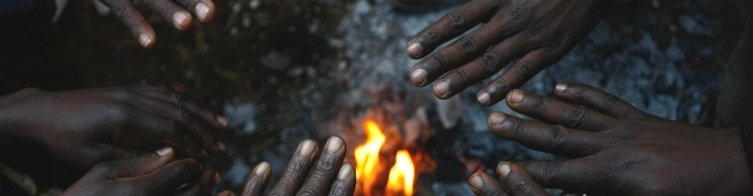 african-hands-around-fire